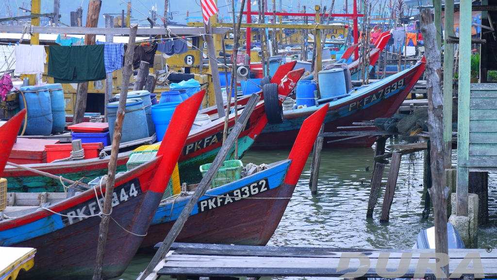 A busy weekday where the river is full of fishing boats.