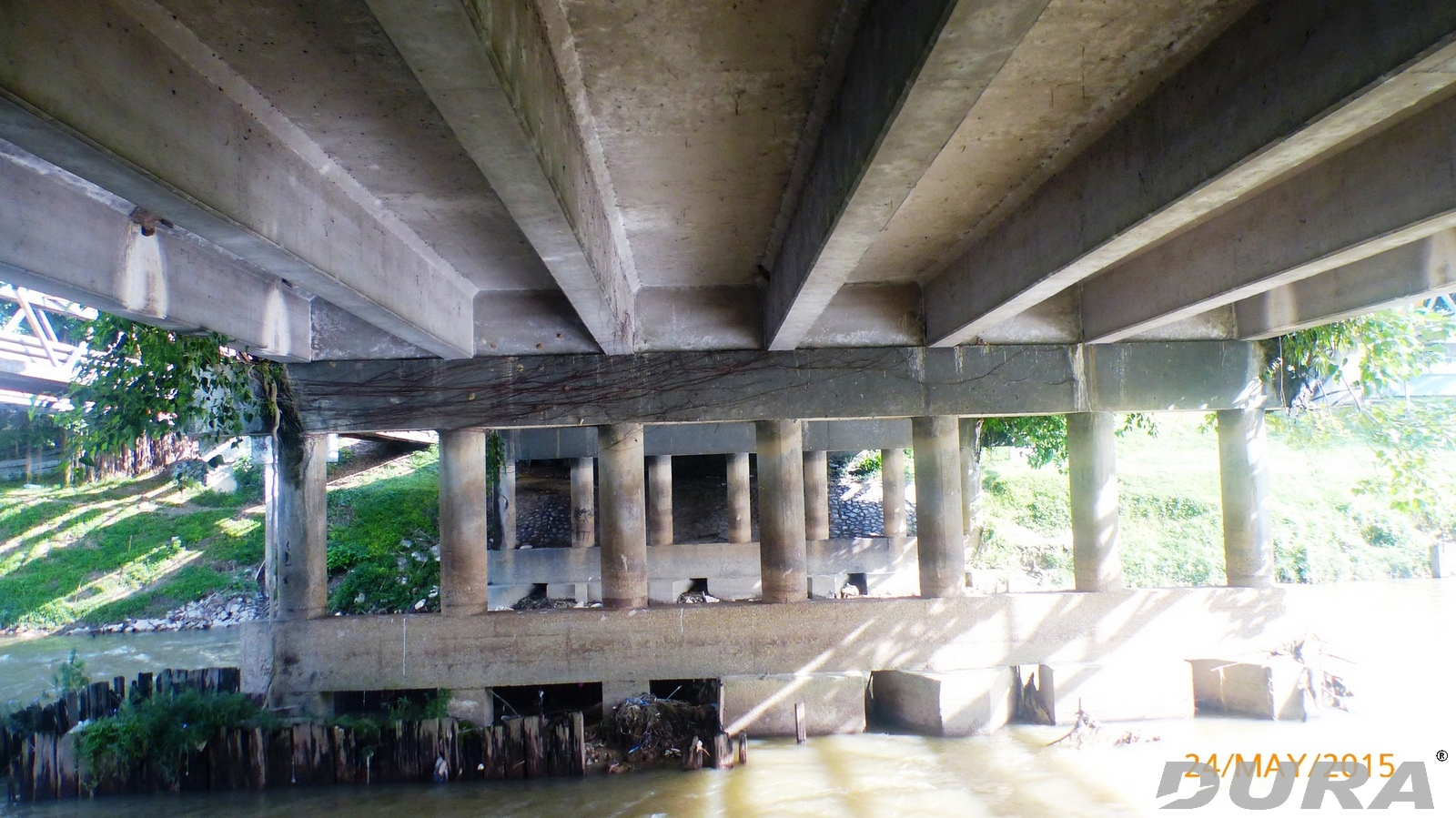 Underneath view of the existing old bridge.