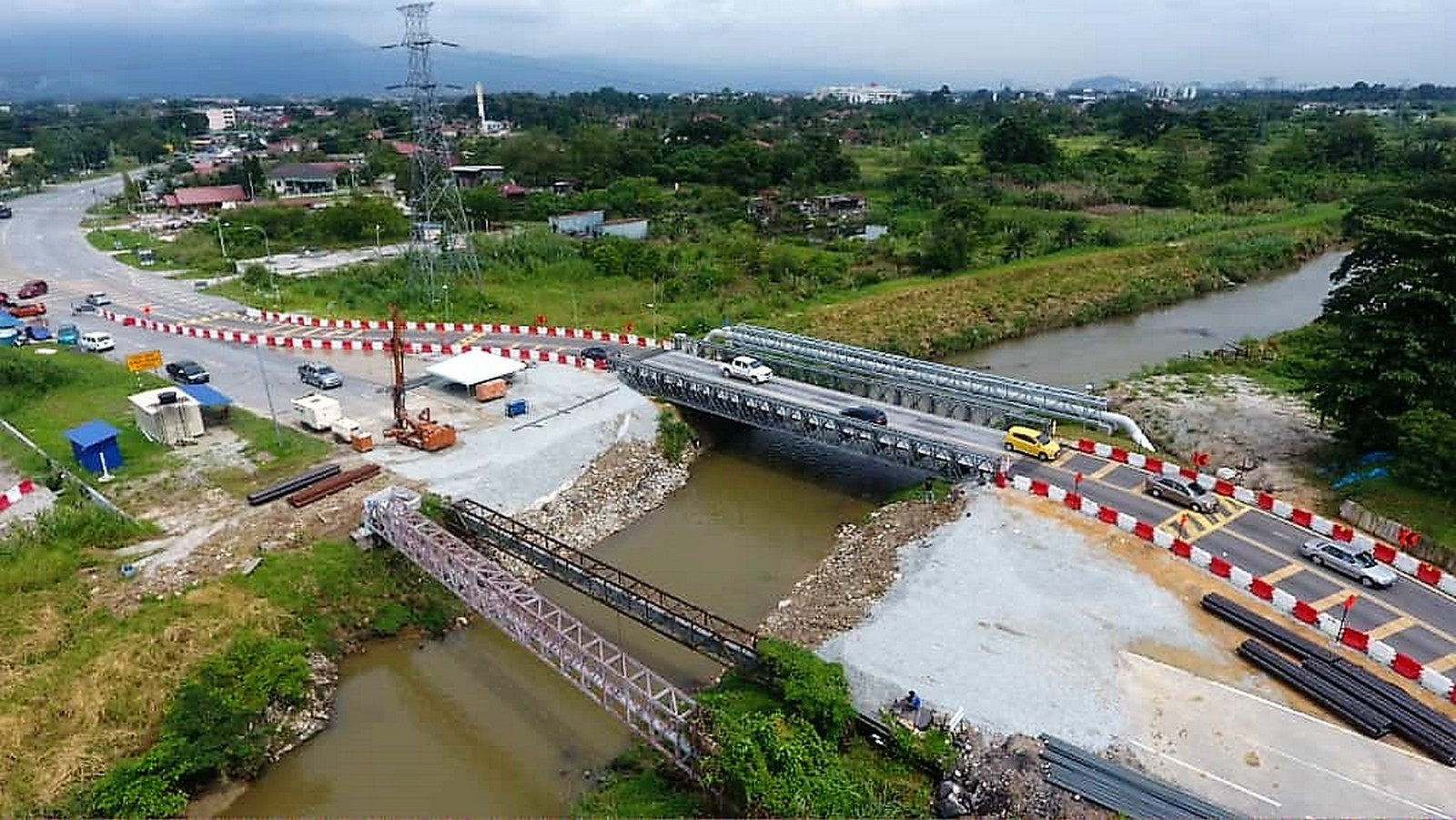 Construction site with temporary bailey bridge installed.