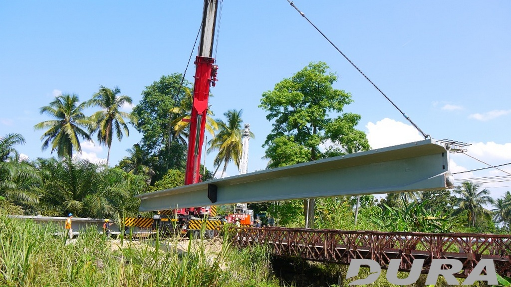 Launching of girders using a single unit 275 tonnes crane.