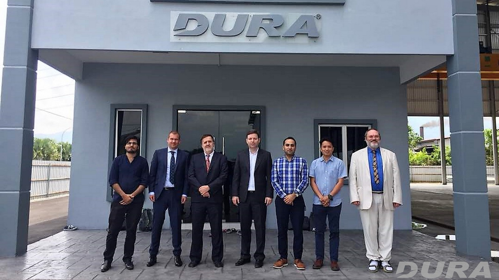 A group photo in front of Dura Technology office (from left: Zain, Martin Berka, Prof. Drahmir Novak, Associate Prof. David Lehky, Dr. Milad, Lee Jun Lit and Dr. Radomir Pukl ) .